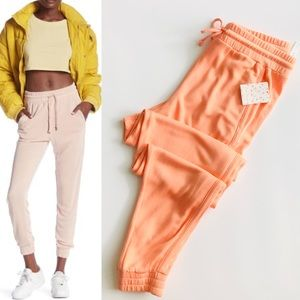 Free People Solid Knit Joggers in neon peach - M